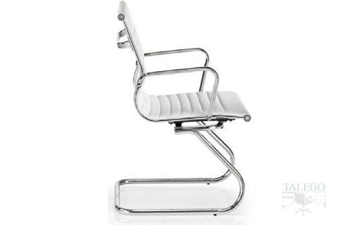 Vista de perfil sillón confidente patín Londresta en polipiel blanco