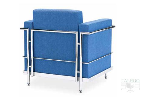 Vista trasera de sofa monoplaza modelo luxor tapizado con estructura métalica