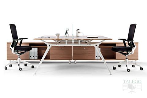 Vista frontal para apreciar la línea tal estilizada de la mesa modelo arkitek